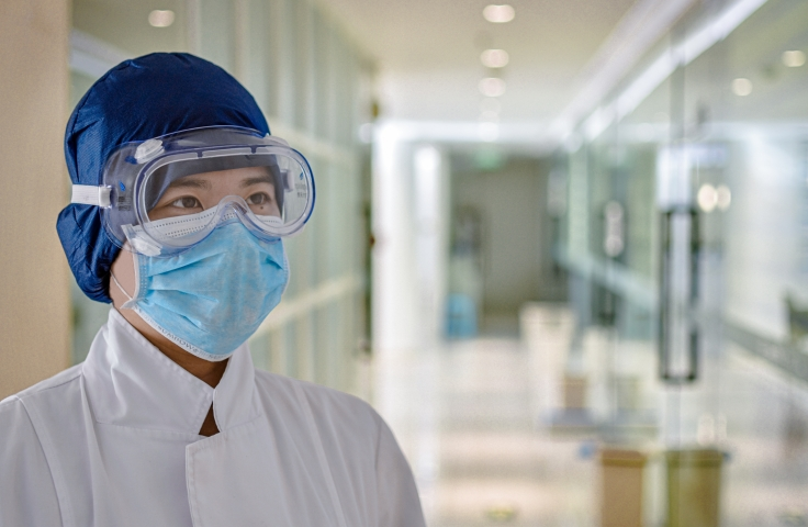Doctor with goggle and face mask