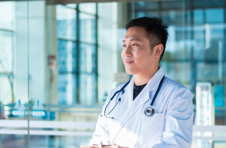 Young Asian Male Doctor Holding a Clipboard
